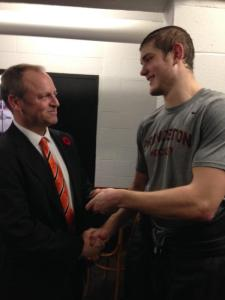 Princeton defenseman Joe Grabwoski hands Ron Fogarty the game puck