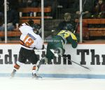 James Howden tries to hit Mike Ambrosia, but goes flying into the boards