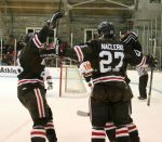 Matt Lorito and Nick Lappin celebrate Marc Naclerio's diving goal