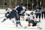 Rob O'Gara and Tom Kroshus collide in neutral ice