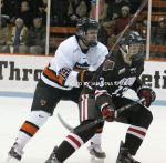 Ryan Berlin and Ben Tegtmeyer chase a puck