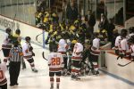 A scrum breaks out between Clarkson and Princeton by the benches