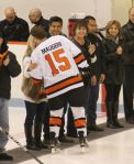 Senior captain Tyler Maugeri gives his mom a kiss during the senior ceremony