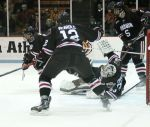 Tim Ernst Sprawls to make a save