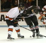Tom Kroshus and Sam Lafferty fight for a puck on Lafferty's eventual goal